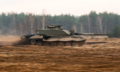 A Challenger 2 main battle tank moving quickly over rough terrain in Poland during Exercise Black Eagle. Around 1,300 UK soldiers were honing their skills in the largest armoured deployment to Eastern Europe for six years. The King's Royal Hussars Battlegroup was taking part in Exercise Black Eagle under the command of the 10th Polish Armoured Cavalry Brigade and alongside the 1st Polish Tank Battalion at the Zagan Training area in south-west Poland. The exercise included both dry-training and live-firing and was designed to develop interoperability between the two Armed Forces. Exercise Black Eagle was a key demonstration of UK support to NATO reassurance measures and follows the RAF's commitment of Typhoon aircraft to the Baltic Air Policing Mission and the deployment of HMS Montrose off the Danish coast as part of the multi-national Baltic Ops exercise in June 2014. Further deployments are expected to take place over the next two years. ------------------------------------------------------- © Crown Copyright 2014 Photographer: SSgt Mark Nesbit RLC (Phot) Image 45158299.jpg from www.defenceimages.mod.uk This image is available for high resolution download at www.defenceimagery.mod.uk subject to the terms and conditions of the Open Government License at www.nationalarchives.gov.uk/doc/open-government-licence/. Search for image number 45158299.jpg For latest news visit www.gov.uk/government/organisations/ministry-of-defence Follow us: www.facebook.com/defenceimages www.twitter.com/defenceimages