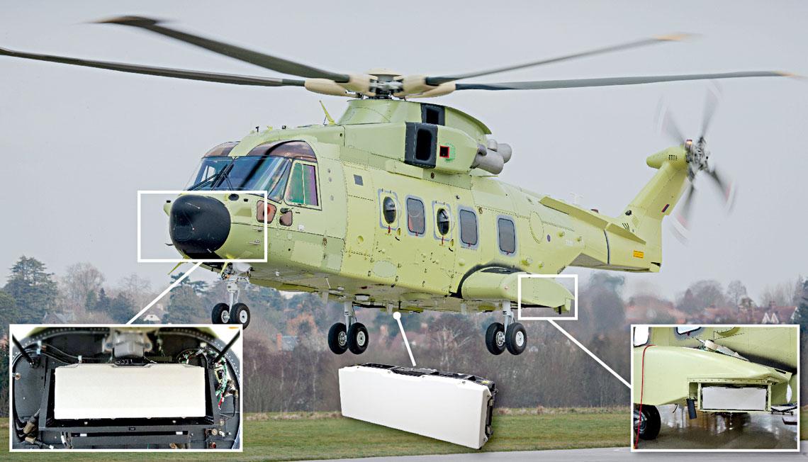 """Zdjęcie wykonane podczas oblotu pierwszego śmigłowca AW101 NAWSARH. Fotografie w """"okienkach"""" pokazują rozmieszczenie i sposób zamontowania jednostek antenowych systemu radiolokacyjnego Osprey MM."""
