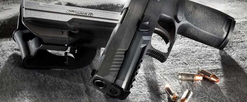 Pistolet Sig Sauer M17 z amunicją