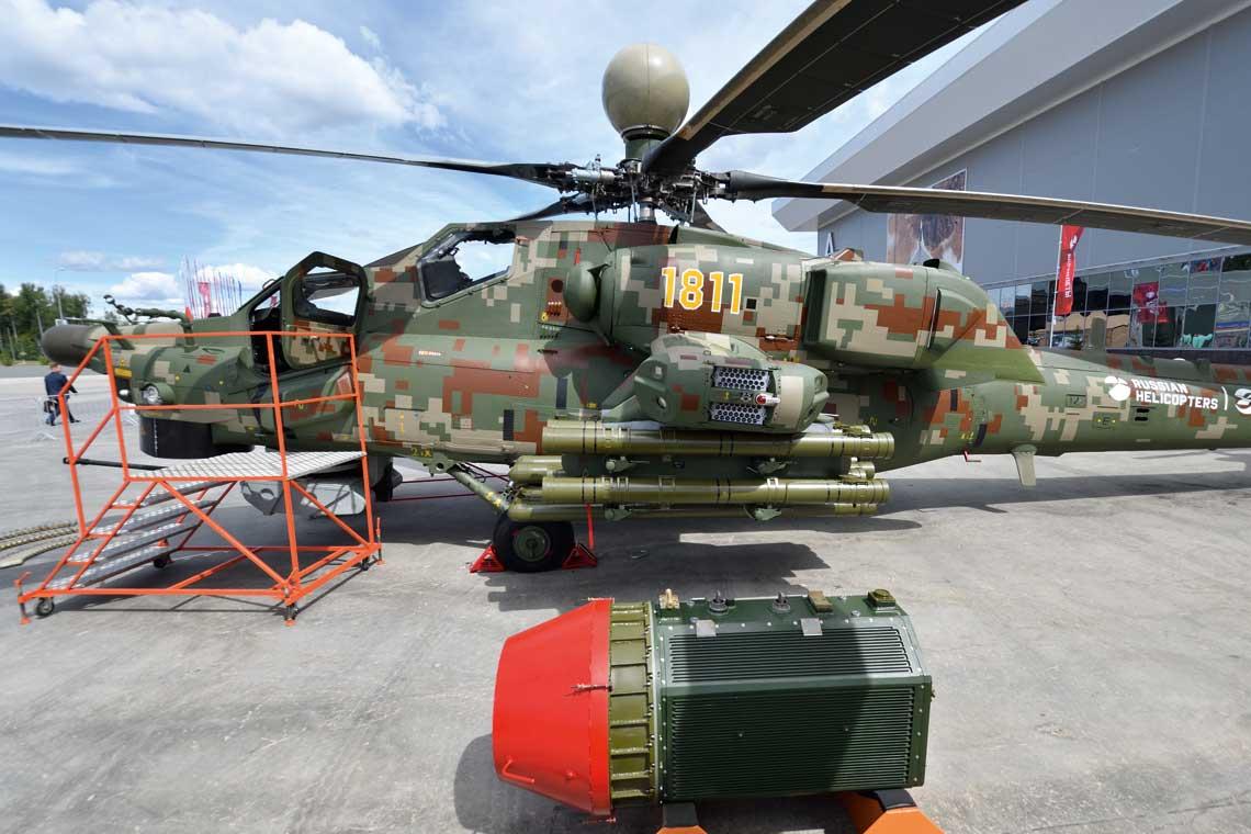 Zmodernizowany Mil Mi-28NE z elementami od Mi-28NM, wtym stacją optoelektroniczną OPS-28M i systemem  samoobrony L370W28 Witebsk. Śmigłowiec jest uzbrojony w przeciwpancerne pociski kierowane Chryzantema, a przed nim leży zasobnik z radarem do ich naprowadzania.