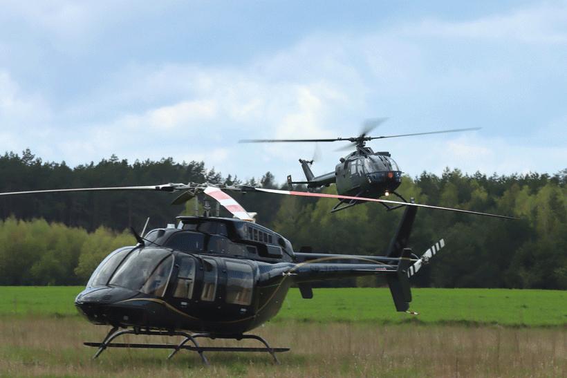 Śmigłowiec Bell 407 oraz prywatny MBB Bo-105 w oryginalnym kamuflażu niemieckiego Lotnictwa Wojsk Lądowych.